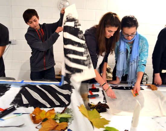 Students working on making a big monotype