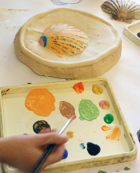 Create relief sculptures from cast plaster and then decorate them with paint, adding gold leaf for that finishing touch.