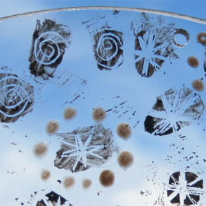 Paula Briggs works with children exploring painting on glass to create hanging roundels with a winter theme.