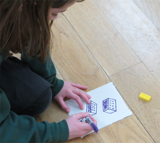 Thinking through perspective by drawing a Lego block