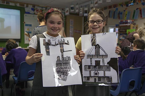 Pupils hold up their traced images