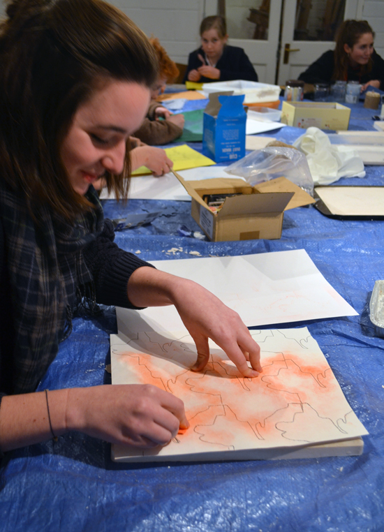 Libby transferring her design from paper to plaster using 'pouncing'