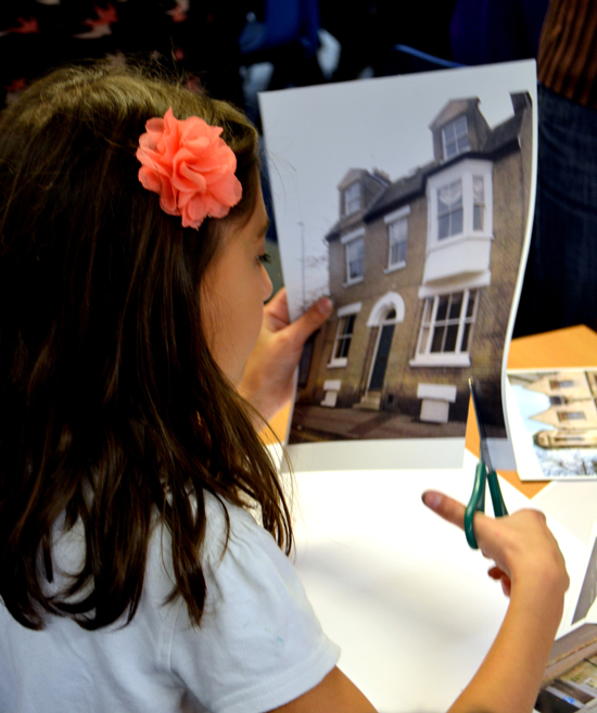 Pupil cuts an image of a local building to collage