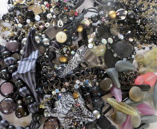 Dark blacks, greys, sparkles... and small beads and jewellery to contrast.