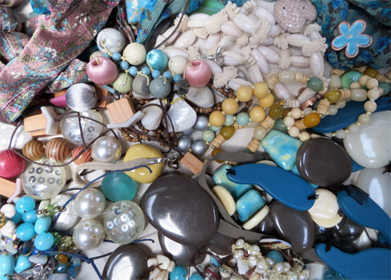 Wonderful mixture of blues, slates, sands... Different textures and weights of larger pieces and an enticing collection of smaller items of rings, earrings, bracelets etc including shells, pearls, metal...