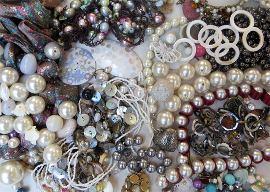 A glorious mix of artificial pearls, shells and other iridescent materials in a mix of sizes, forms, textures.