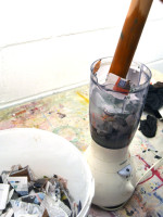 Make sure that the the blender is unplugged and use a rolling pin to push the paper down into the water 1