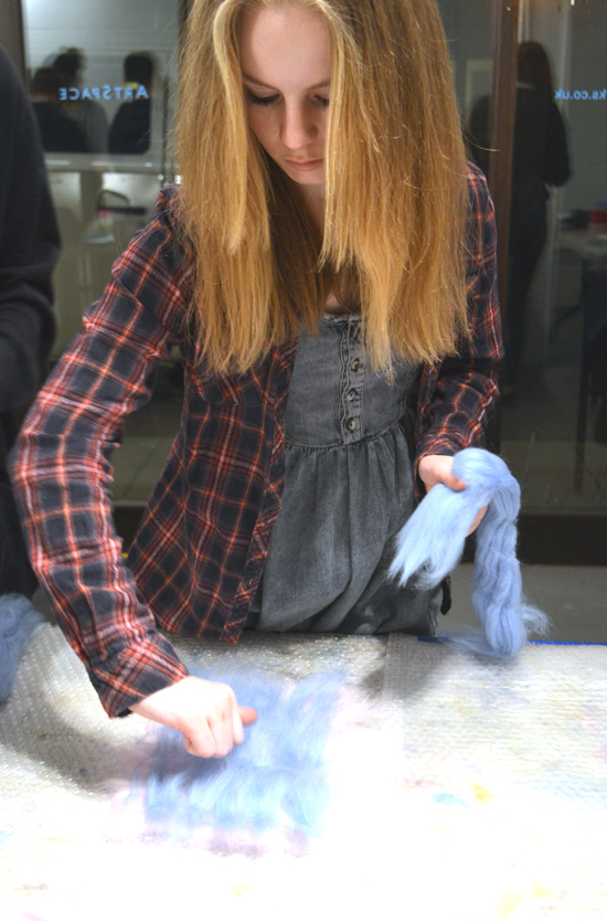 This resource records an enjoyable and energetic felt-making session where students experimented with mixing coloured layers of fleece and trapping small objects within the felt, to make tactile and vibrant pieces of fabric