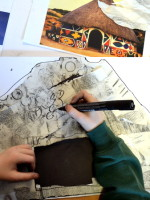 Looking at detail and drawing with black pen