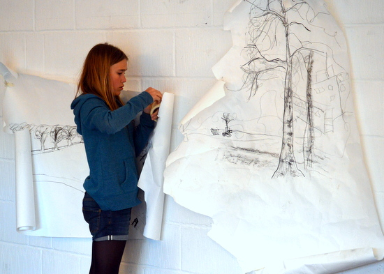 student puts windy drawing on the wall at artworks