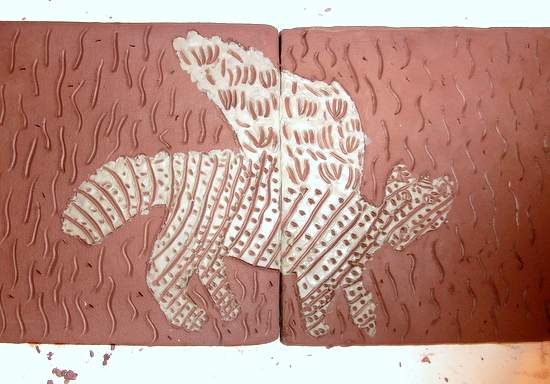 Scraffito onto a clay tile with a coloured slip