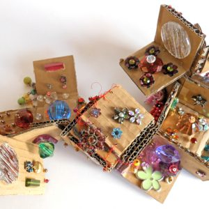 """Artist Andrea Butler uses cardboard and jewellery to explore a simple design and construction exercise, working within the limitations of a right angle. <a href=""""http://""""/transformation-project-cardboard-and/"""""""" class=""""shortcode button    """"xlarge"""" style=""""background-color: """"#78608e"""";color: """"#ffffff"""";"""">Read More</a>"""