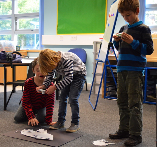 Year 3 & 4 pupils working together to animate their 'beasts'