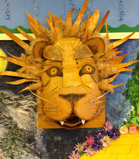 I studied fashion/textile design and have worked in both the fashion industry and the graphic design industry. Sewing, mixed media and model making are skills that I bring to my classes. This Aslan lion model was created by a group of children to represent their school 'House'.