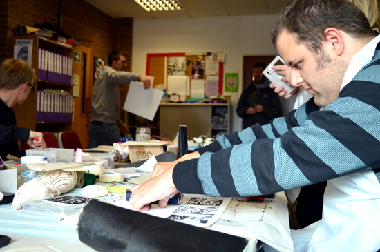 Steve block printing: using a clean roller to press his print onto the paper