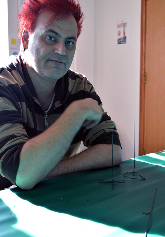 Robert and three pieces of modelling wire standing