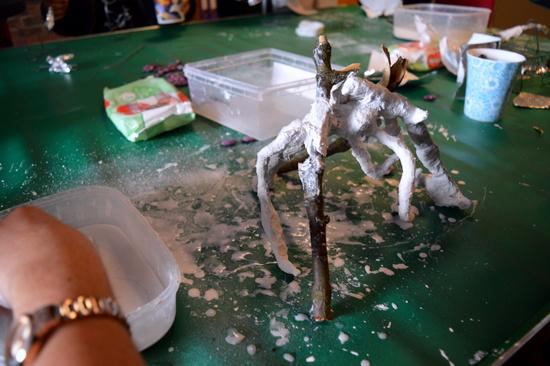 Shani working with sticks, wire and Modroc