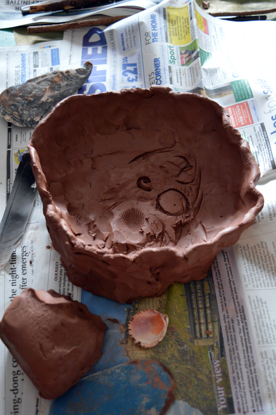 Clay mould made by pressing objects from nature into fresh clay