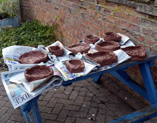 Clay moulds outside ready for plaster to be poured in to make a cast