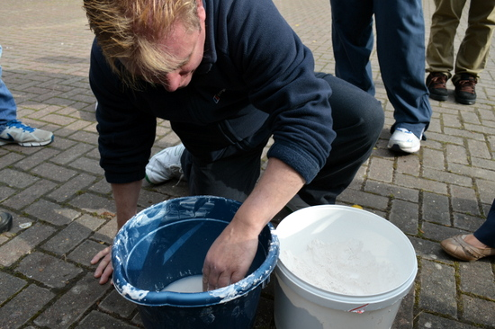 Student learns how to mix plaster