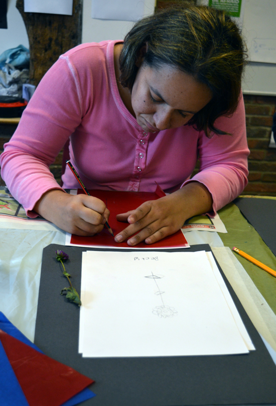 Student at Red2Green drawing through carbon paper