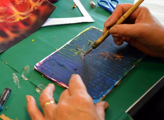 Scraffito into dark pastel over coloured board