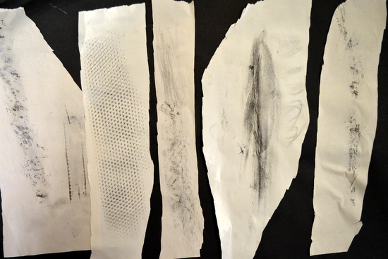Composition of cut rubbings on black paper