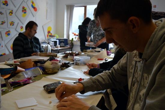 Creating designs by pressing small shells into foam board