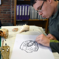 Learner at Red2Green drawing a skull on loan from University of Cambridge Museum of Zoology