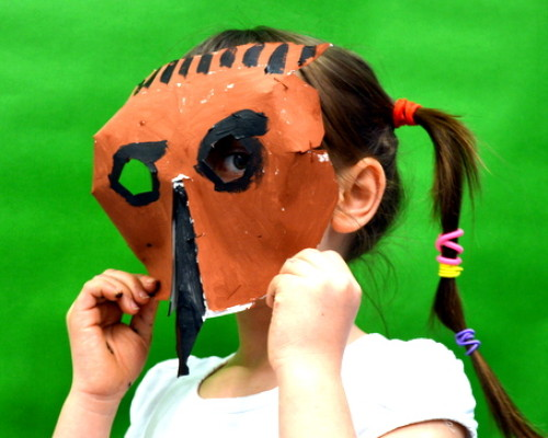 Pupils put finishing touches on their animal masks using paint