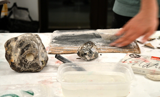 Students build their drawings with layers of modroc and graphite to echo the very forming of the rocks