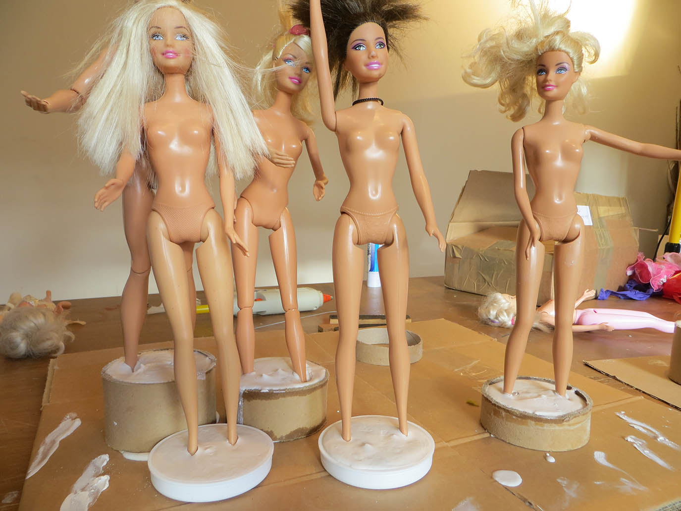 Barbies standing in plaster bases