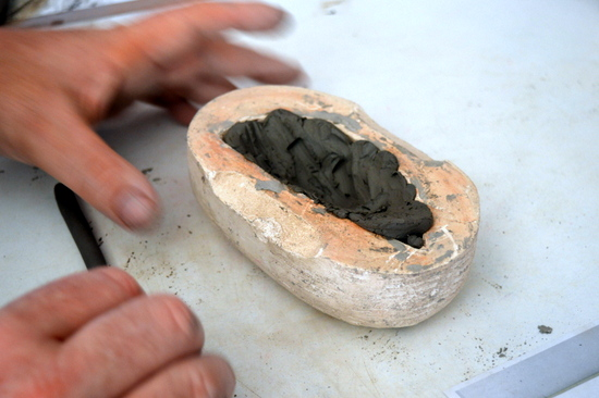 Initially Mark pressed clay into the mould