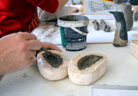 Mark had scored the clay on both halves of the mould before painting on the clay slip