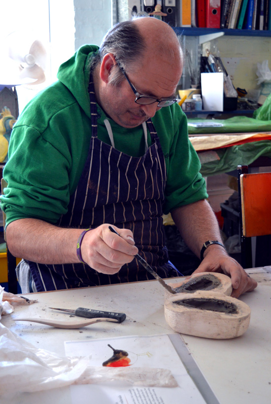 Mark paints slip onto clay to join the two parts together