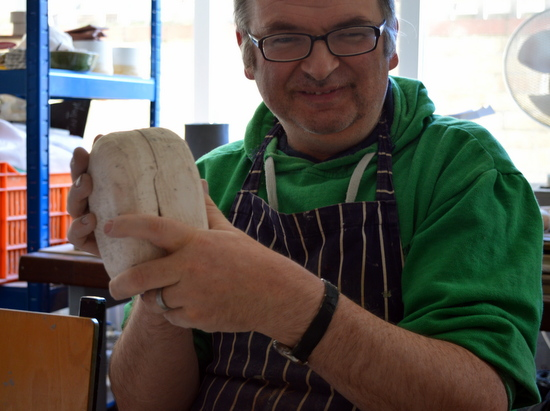 Mark squeezes the two halves of the mould together