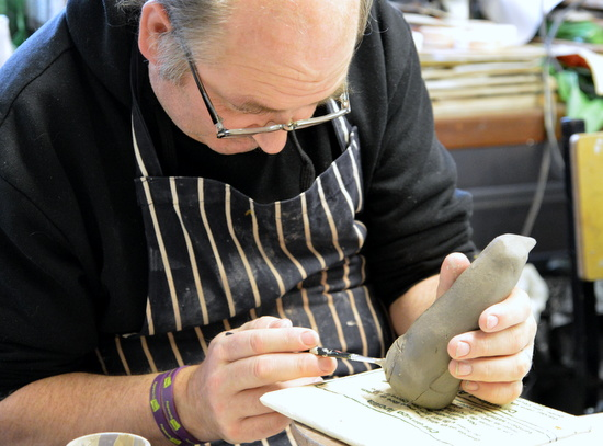 Mark paints his penguin
