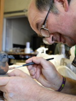 Mark paints his robin's red breast