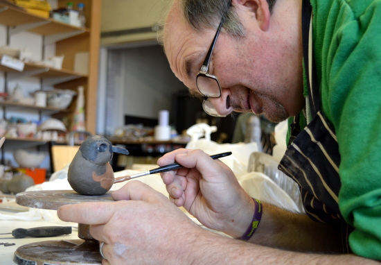 Mark paints his dotterel bird- Rowan