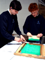 Boys get to work! Andy encourages experimenation and working by trial and error to explore screen printing