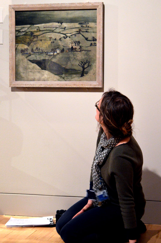 Kate looking at Ben Nicholson and guides teachers into the painting