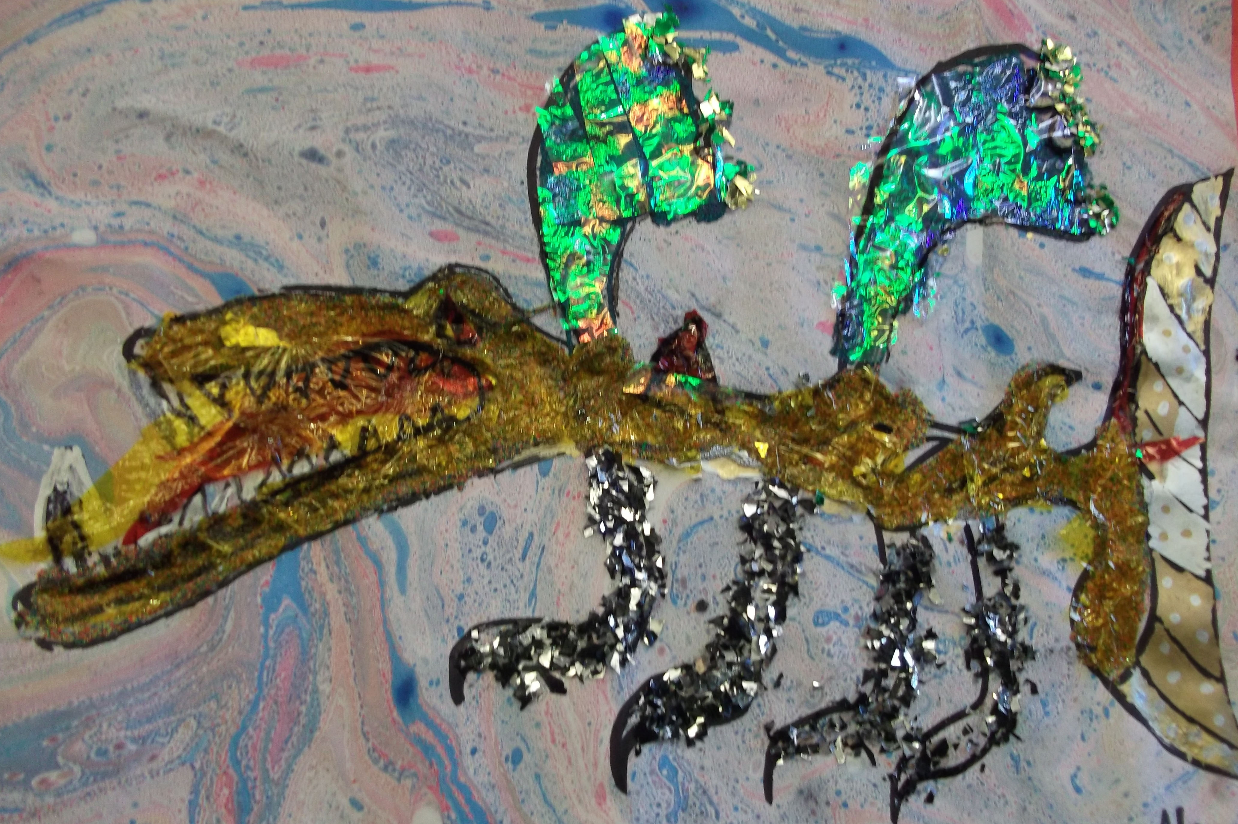 Mixed media collage of a dragon by Y4 child, inspired by Uccello's St George and the Dragon