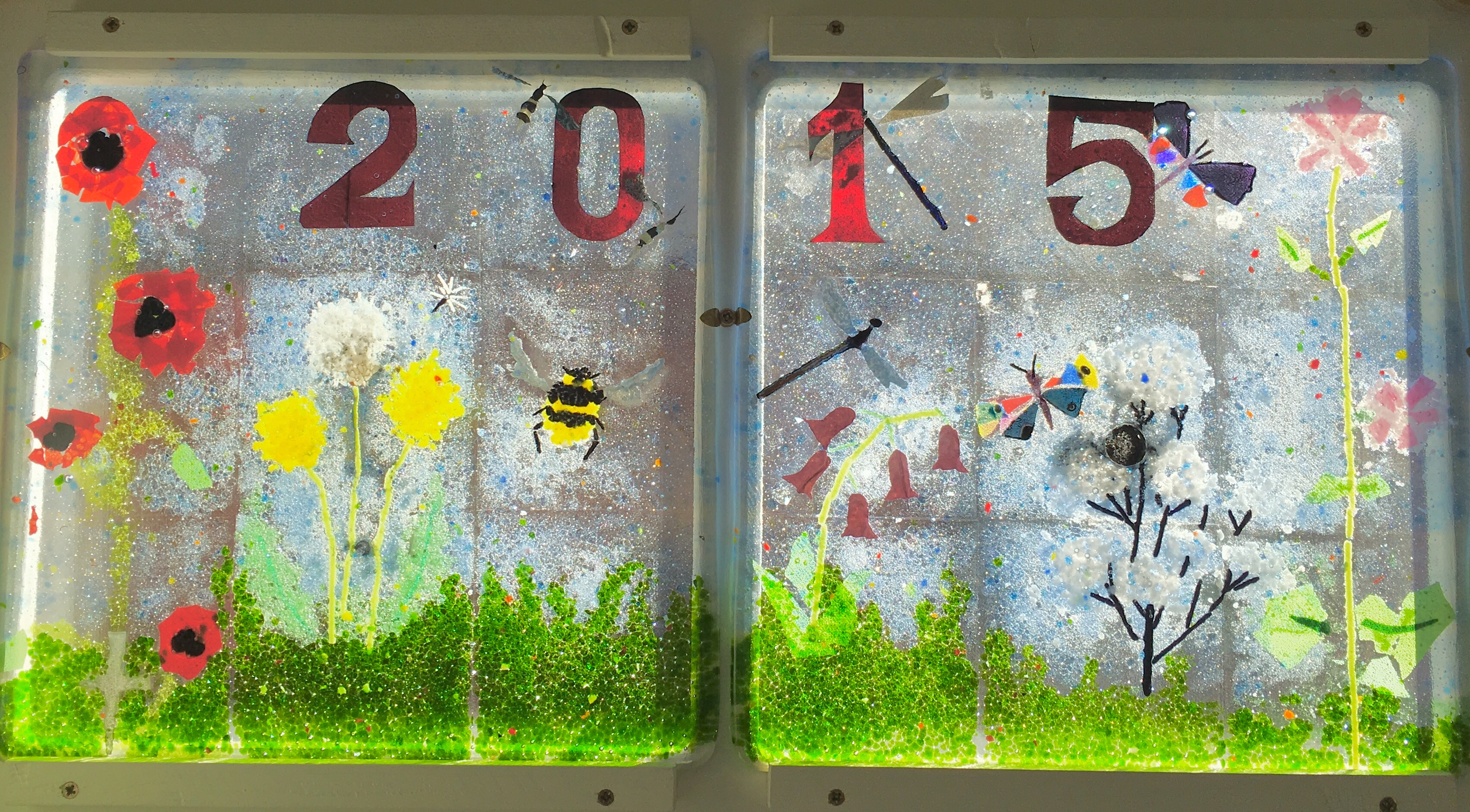 One of ten glass fused panels made by Y6, part of the 2015 leavers legacy window