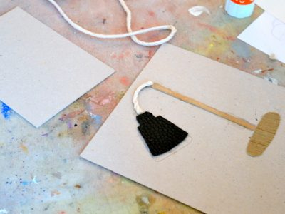 An introduction to making collagraphs by making small textured plates using grey board, glue, string and rope.