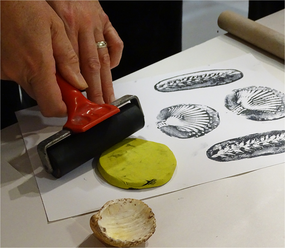Place the Plastacine down onto the Paper and use a Roller to apply Pressure