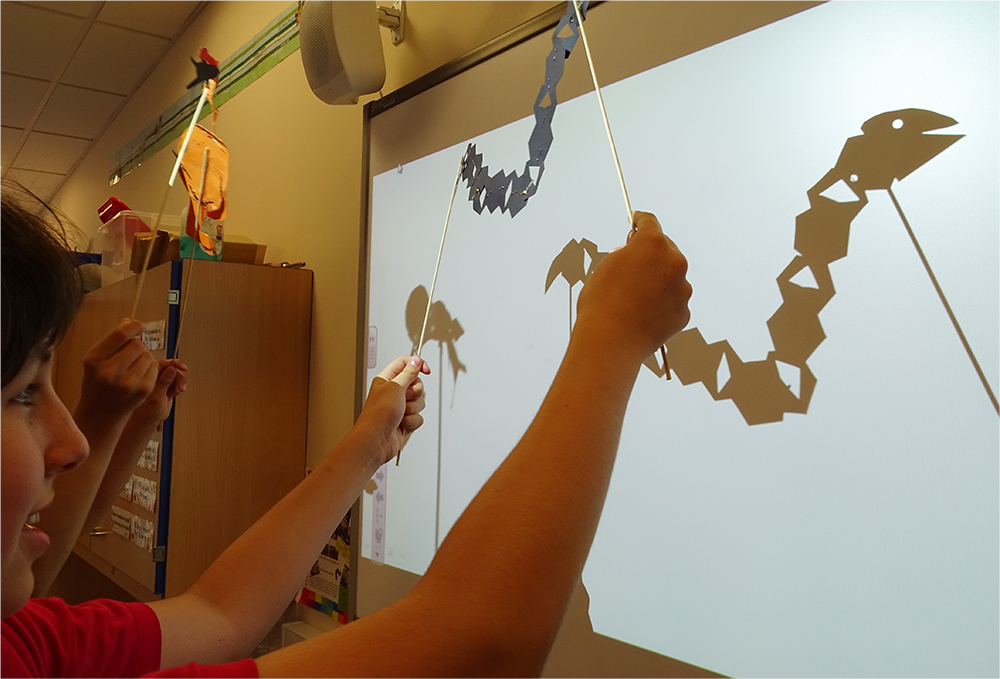 Make intricately patterned shadow puppets out of card and mixed media then create your own shadow performances on a white board.