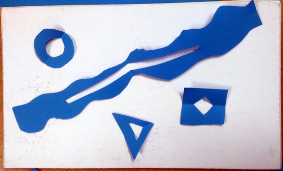 Students cut shapes out of paper and laid them onto a piece of mount board