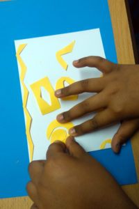 Pupil explores composition with cut out shapes and stencils