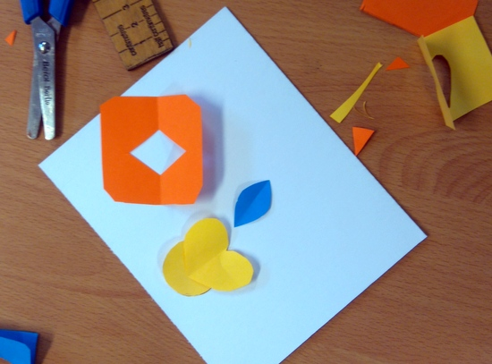 Pupils cut shapes and arrange them on the mount board