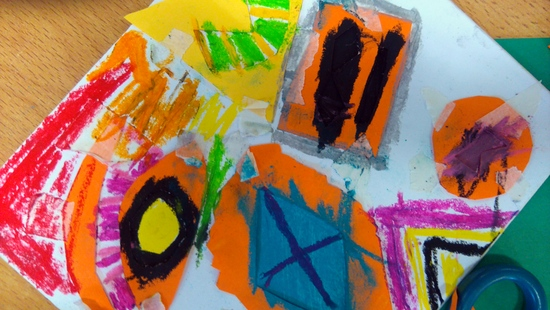 Pupils use oil pastels to fill the board around the shaped stencils and are encouraged to experiment with their mark making